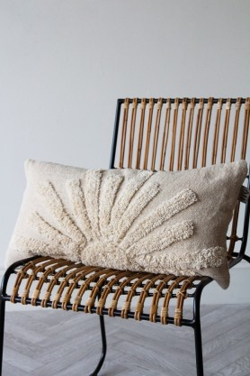 Image of the Natural Multi-Texture Sunrise Cushion sat on a chair