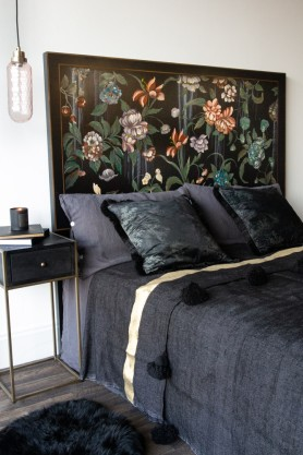 Angled lifestyle image of the Oriental Black Floral Headboard