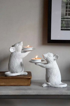Lifestyle image of the Pair Of White Mouse Candle Holders