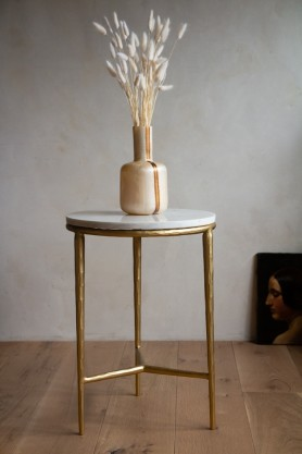 Lifestyle image of the Perfect Marble Topped Gold Side Table on a light background