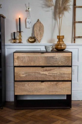 Front on lifestyle image of the Raw Rustic Style Chest Of Drawers