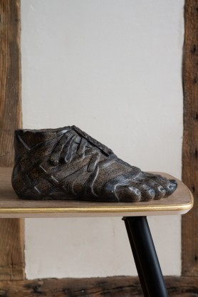 Image of the Roman Sandal Distressed Foot Ornament on a table