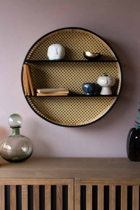 Lifestyle Image of the Round Woven Cane Rattan Shelf Unit