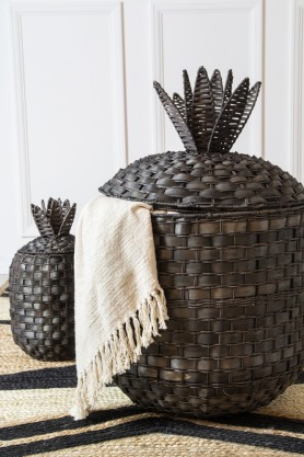 Lifestyle image of the Set Of 2 Rattan Pineapple Storage Baskets