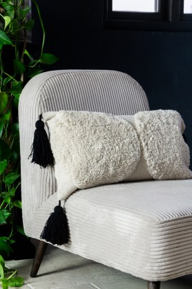 Close-up lifestyle image of the Ivory Cream Soft Cotton Tufted Dots Cushion on a chair