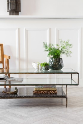 Close-up lifestyle image of the right side of the Three-Tier Glass Coffee Table