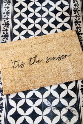 Lifestyle image of the Tis The Season Christmas Doormat