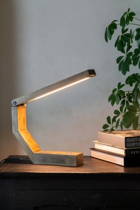 Lifestyle image of the Unique Design Wooden LED Table Task Lamp switched on