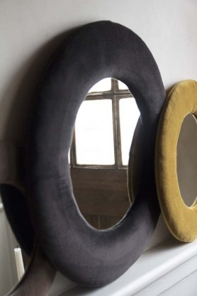 Image of the Round Velvet Frame Mirror In Charcoal Grey next to the Ochre Gold version