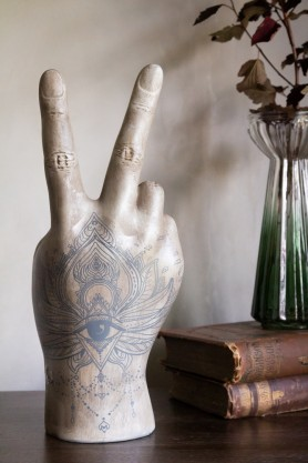 Image of the back of the hand on the Large Tattooed Peace Hand Ornament