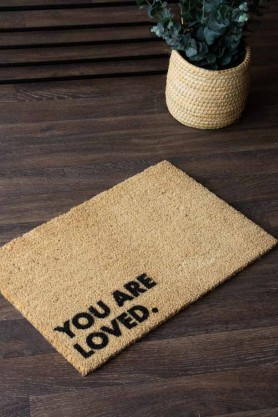 Lifestyle image of the You Are Loved Doormat