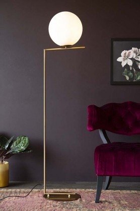 Lifestyle image of the Art Deco White Sphere Floor Lamp switched on