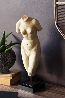 Lifestyle image of The Female Form Figurine on a shelf