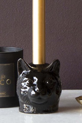 Lifestyle image of the Black Cat Candle Holder with a candle in it