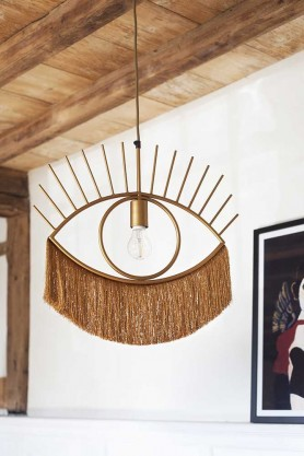 Lifestyle image of the Golden Eye Pendant Light With Fringing