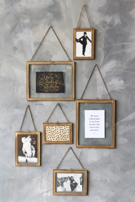 Lifestyle image of various shapes and sizes of the Wall Hung Brass Picture Frames