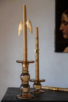 Lifestyle image of the Angel Wings Candle Decoration set on a candle