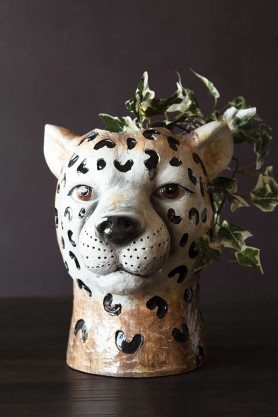 Lifestyle image of the Cute Cheetah Vase with trailing ivy in it