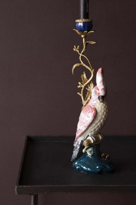 Lifestyle image of the Ceramic & Brass Cockatoo Candle Holder