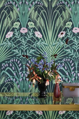 Close-up lifestyle image of the Bluebell Wallpaper in Sage, Mint & Lilac On Charcoal by Cole & Son