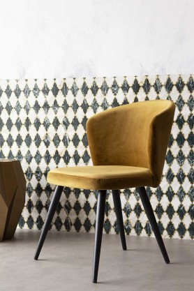 Angled lifestyle image of the Golden Ochre Deco Velvet Dining Chair