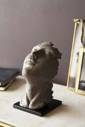 Lifestyle image of the small Distressed Stone Effect Resting Head Ornament