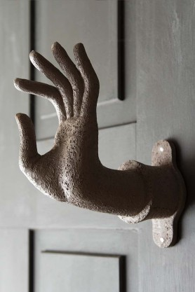 Lifestyle image of the Distressed Stone Effect Om Mudra Hand Wall Art / Coat Hook