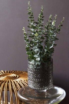 Lifestyle image of the Faux Eucalyptus Plant For A Pot
