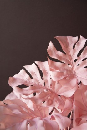 Close-up lifestyle image of the Large Pink Faux Monstera House Plant