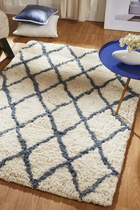 Lifestyle image of the Geo Diamond Print Rug in Sapphire Blue