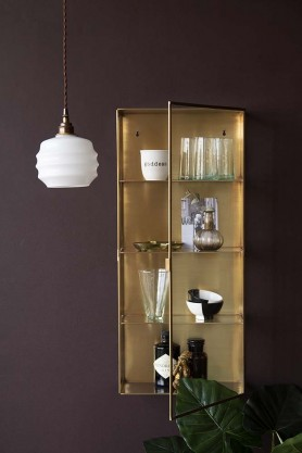 Lifestyle image of the Brass & Glass Wall-Mounted Display Cabinet with pendant light