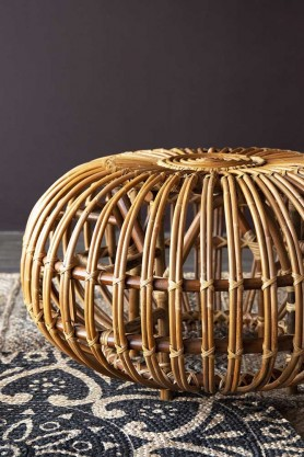 Front on lifestyle image of the Handmade Woven Wicker Pouffe