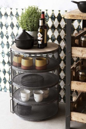 Lifestyle image of the Industrial-Style 4-Shelf Barrel Mesh Storage Cabinet