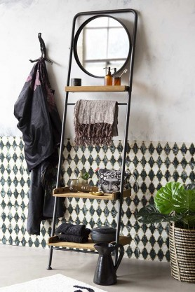 Lifestyle Image of the Industrial-Style Ladder Shelf Unit With Round Mirror