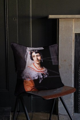 Lifestyle image of Isabella cushion in a traditional portrait style