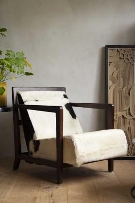 Lifestyle image of the Angular Mojave Cowhide Armchair