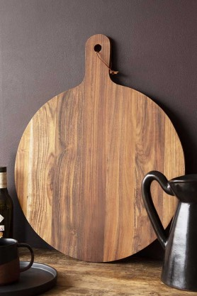 Lifestyle image of the front of the Natural Acacia Round Chopping Board