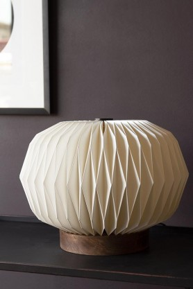 Lifestyle image of the Origami Paper & Mango Wood Table Lamp not lit