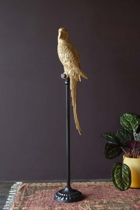 Lifestyle image of the magnificent tall golden parrot on his perch