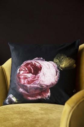 Lifestyle image of the Single Pink Rose Velvet Cushion