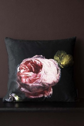Lifestyle image of the Single Pink Rose Velvet Cushion on bench
