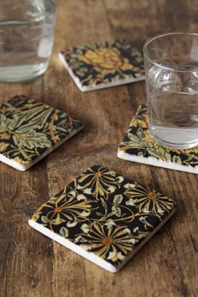 Lifestyle image of the Set Of 4 Vintage Style Floral Ceramic Coasters