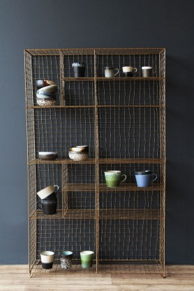Standing brass industrial storage rack with crockery on each shelf