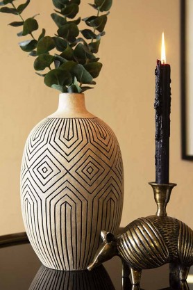 Lifestyle image of the Stone & Black African Ceramic Bottle Vase