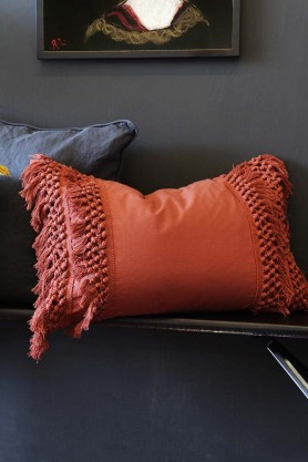 Lifestyle image of the Paprika Tassel Cotton Cushion