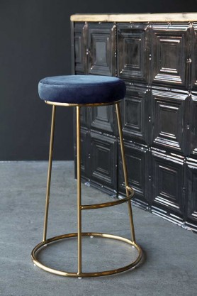 Lifestyle image of the Atlantis Velvet Bar Stool in Petrol Blue