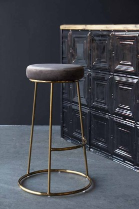 Lifestyle image of the Atlantis Velvet Bar Stool in Mushroom