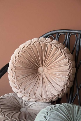 Lifestyle image of the Vintage Style Velvet Rouched Round Cushion in Soft Pink