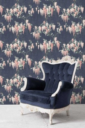 Lifestyle image of the Wisteria Midnight Mint Wallpaper by Pearl Lowe