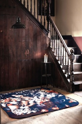 lifestyle image of Rose Garden Rug with large wooden staircase and black ceiling light above it